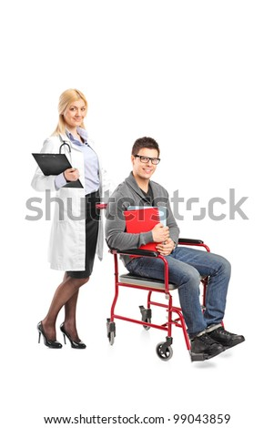 Full length portrait of a healthcare practitoner pushing a man in wheelchair isolated against white background