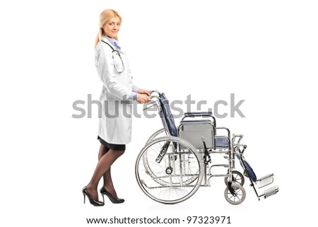 Full length portrait of a healthcare professional pushing a wheelchair isolated on white background