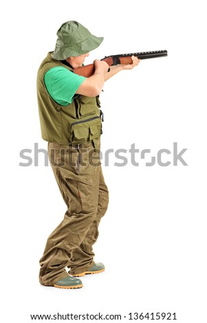 Full length portrait of a hunter with a rifle, isolated on white background