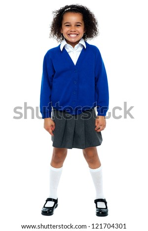 Full length portrait of a joyous African school girl. All against white background. - stock photo