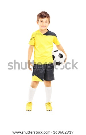 Full length portrait of a kid in sportswear holding a soccer ball isolated on white background - stock photo
