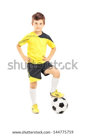 Full length portrait of a kid in sportswear posing with a soccer ball isolated on white background - stock photo