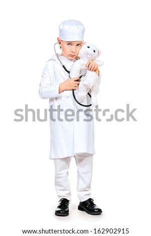 Full length portrait of a little boy playing a doctor veterinarian. Different occupations. Isolated over white. - stock photo