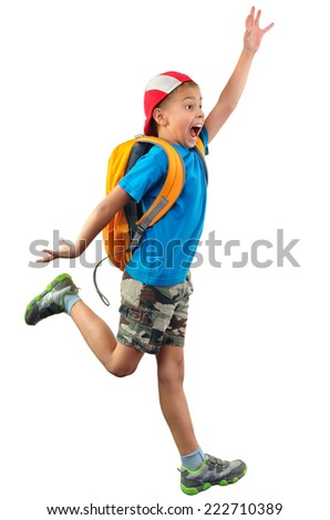 Full length portrait of a little boy with backpack and a cap running, jumping, waving with his hand and shouting. He is about or fall down.  Isolated over white background.  - stock photo