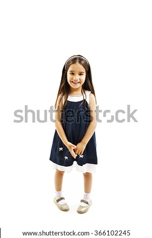 Full length portrait of a little girl standing. Isolated on white background - stock photo