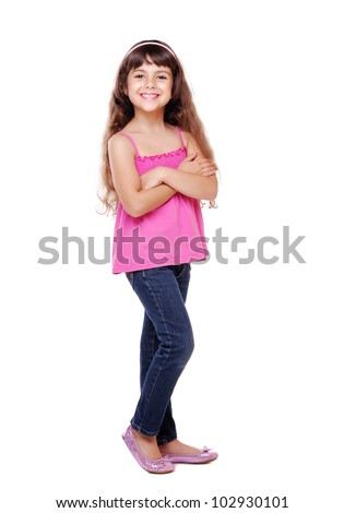 Full length portrait of a little girl standing with folded hands over white background - stock photo