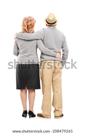 Full length portrait of a lovely mature couple isolated on white background, rear view - stock photo