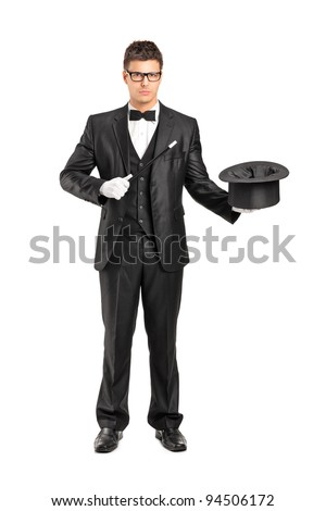 Full length portrait of a magician holding a magic wand and top hat isolated on white background - stock photo