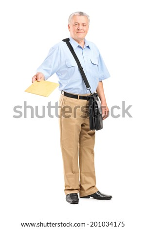 Full length portrait of a mailman handing an envelope towards the camera isolated on white background - stock photo