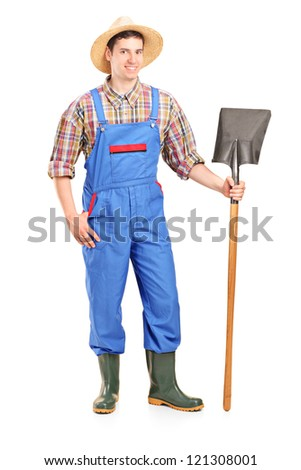 Full length portrait of a male agricultural worker holding a shovel isolated on white background - stock photo