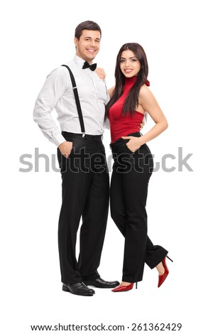 Full length portrait of a male and female fashion models posing isolated on white background - stock photo
