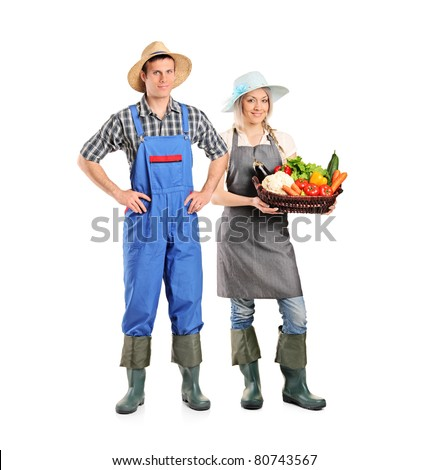 Full length portrait of a male and female gardeners isolated on white background