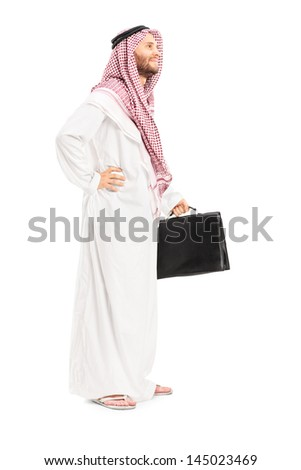 Full length portrait of a male arab person with suitcase posing isolated on white background - stock photo