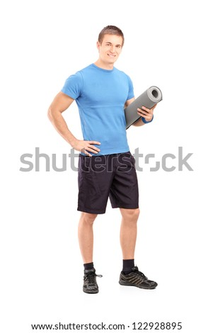 Full length portrait of a male athlete holding a mat isolated on white background - stock photo
