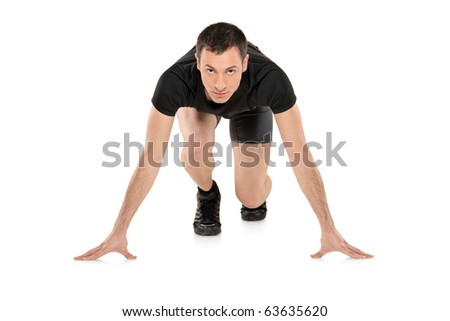 Full length portrait of a male athlete ready to run isolated on white background - stock photo