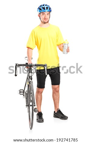 Full length portrait of a male biker holding a water bottle isolated on white background - stock photo