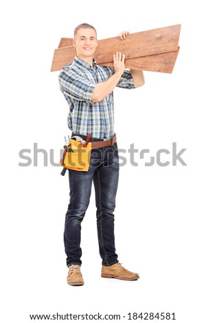 Full length portrait of a male carpenter carrying planks over his shoulder isolated on white background
