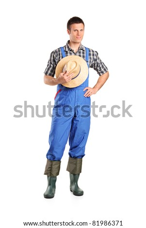 Full length portrait of a male farmer posing isolated against white background