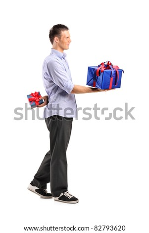 Full length portrait of a male giving a large gift and hiding a small one isolated on white background - stock photo