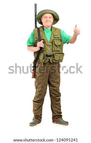 Full length portrait of a male hunter with shotgun giving a thumb up isolated on white background
