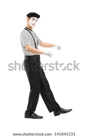 Full length portrait of a male mime artist performing isolated on white background - stock photo