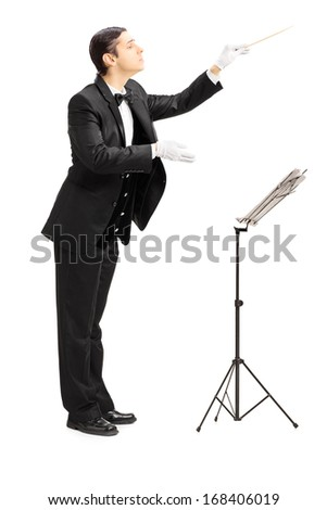 Full length portrait of a male orchestra conductor directing with stick isolated against white background - stock photo