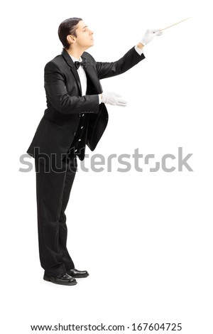Full length portrait of a male orchestra conductor directing with stick isolated on white background