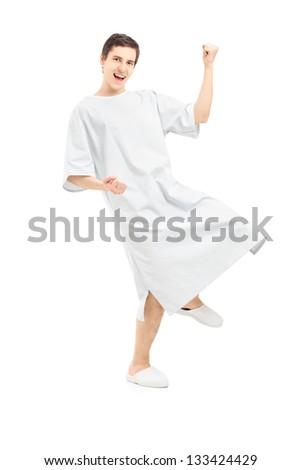 Full length portrait of a male patient gesturing happiness, isolated on white background