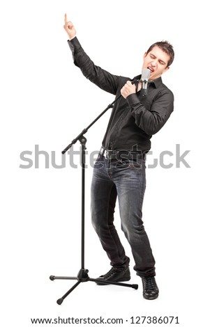Full length portrait of a male singer performing a song isolated on white background - stock photo