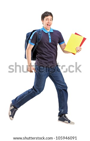 Full length portrait of a male student jumping with notebooks in his hand isolated on white background