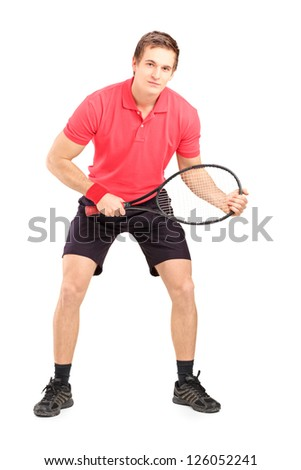 Full length portrait of a male tennis player holding a racket isolated on white background - stock photo
