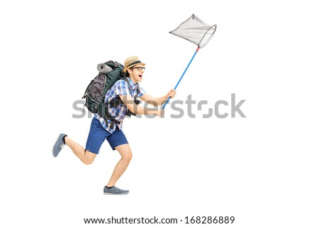 Full length portrait of a male tourist running with butterfly net isolated on white background - stock photo