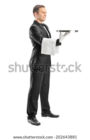 Full length portrait of a male waiter serving and holding a tray isolated on white background - stock photo