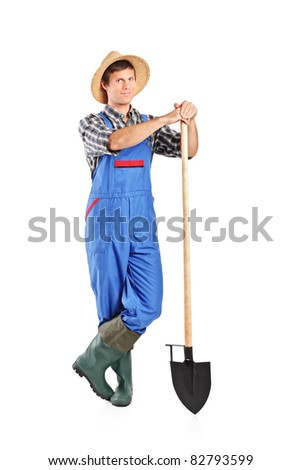Full length portrait of a male worker holding a shovel isolated on white background