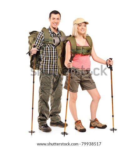 Full length portrait of a man and woman in sportswear with backpacks and hiking poles isolated on white background - stock photo