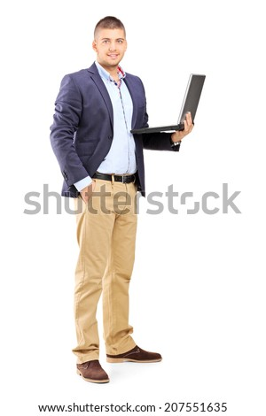 Full length portrait of a man holding a laptop isolated on white background