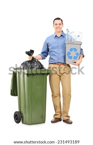 Full length portrait of a man holding a recycle bin by a trash can isolated on white background - stock photo