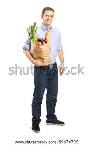 Full length portrait of a man holding a shopping bag isolated on white background - stock photo