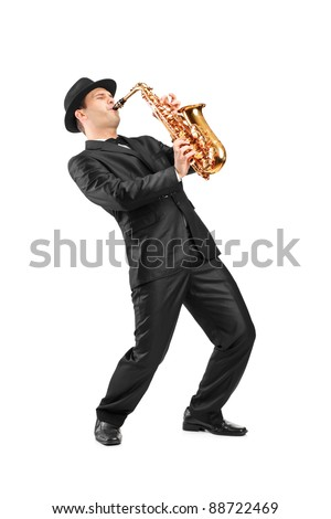 Full length portrait of a man in a suit playing on saxophone isolated on background