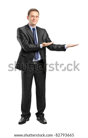 Full length portrait of a man in suit gesturing welcome isolated on white background - stock photo