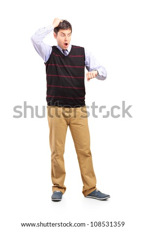 Full length portrait of a man looking at his watch, isolated on white background - stock photo
