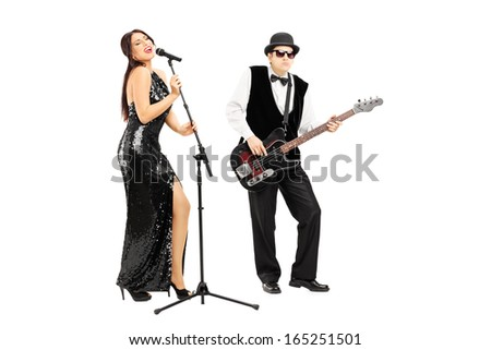 Full length portrait of a man playing a bass guitar and woman singing isolated on white background