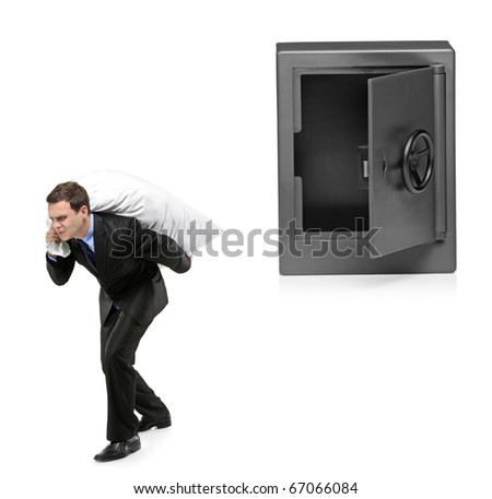 Full length portrait of a man stealing a money bag from a deposit safe isolated on white background - stock photo
