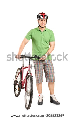 Full length portrait of a man with a helmet pushing a bike isolated on white background - stock photo