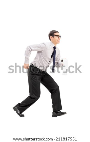 Full length portrait of a man with toilet paper rushing to a bathroom isolated on white background - stock photo