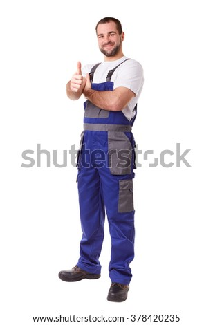 Full length portrait of a manual worker makes a gesture thumbs up - stock photo