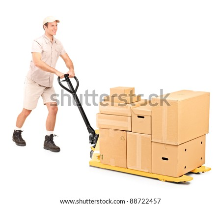 Full length portrait of a manual worker pushing a fork pallet truck isolated against white background - stock photo