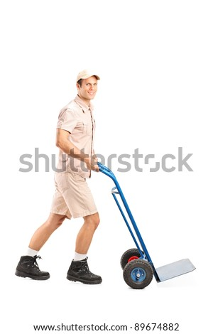 Full length portrait of a manual worker pushing an empty handtruck isolated on white background - stock photo