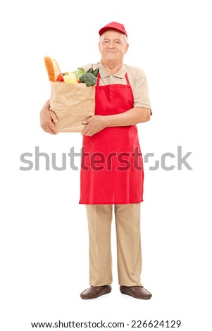 Full length portrait of a market vendor holding a bag full of groceries isolated on white background - stock photo