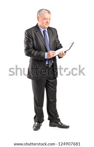 Full length portrait of a mature businessman looking at documents isolated on white background - stock photo